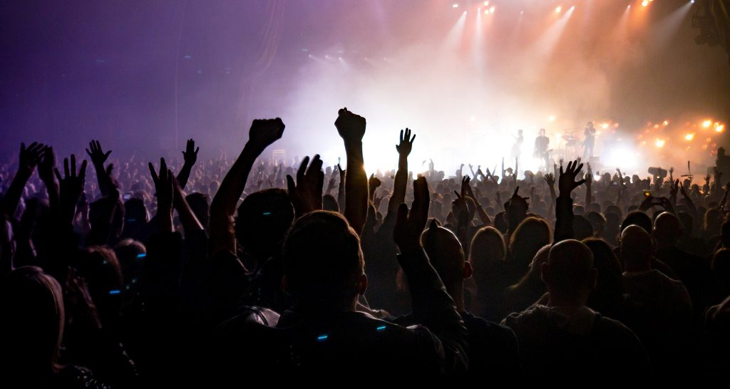 Hands up in a crowd at a concert
