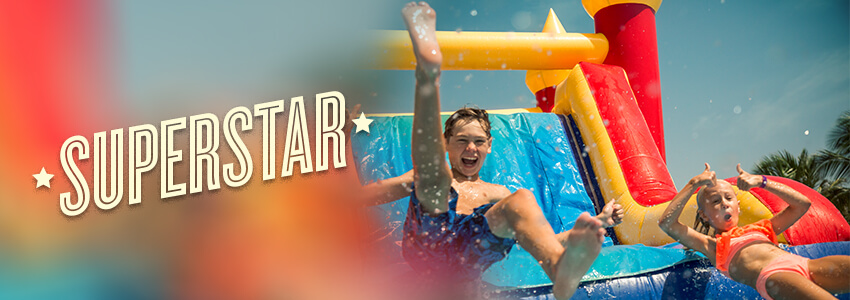 Superstar kids on a water slide